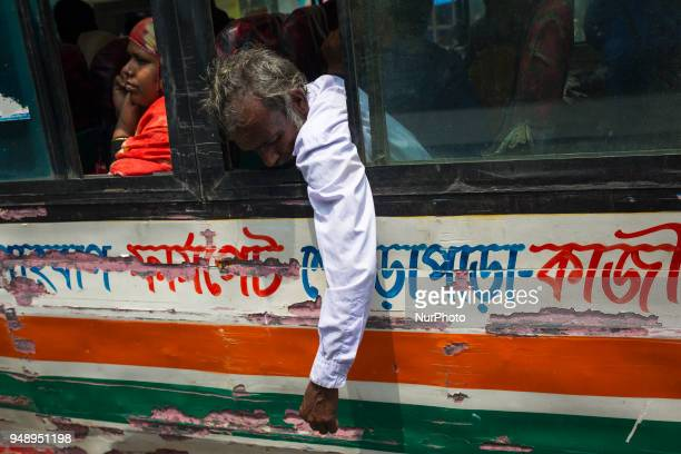 A passenger keep his hand outside a running bus on a busy street in Dhaka Bangladesh on April 19 2018 At least 4284 people including 516 women and...