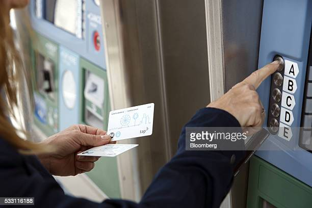 A passenger loads a TAP fare card at the Metro Expo Line light rail station in Santa Monica California US on Friday May 20 2016 The extension opened...