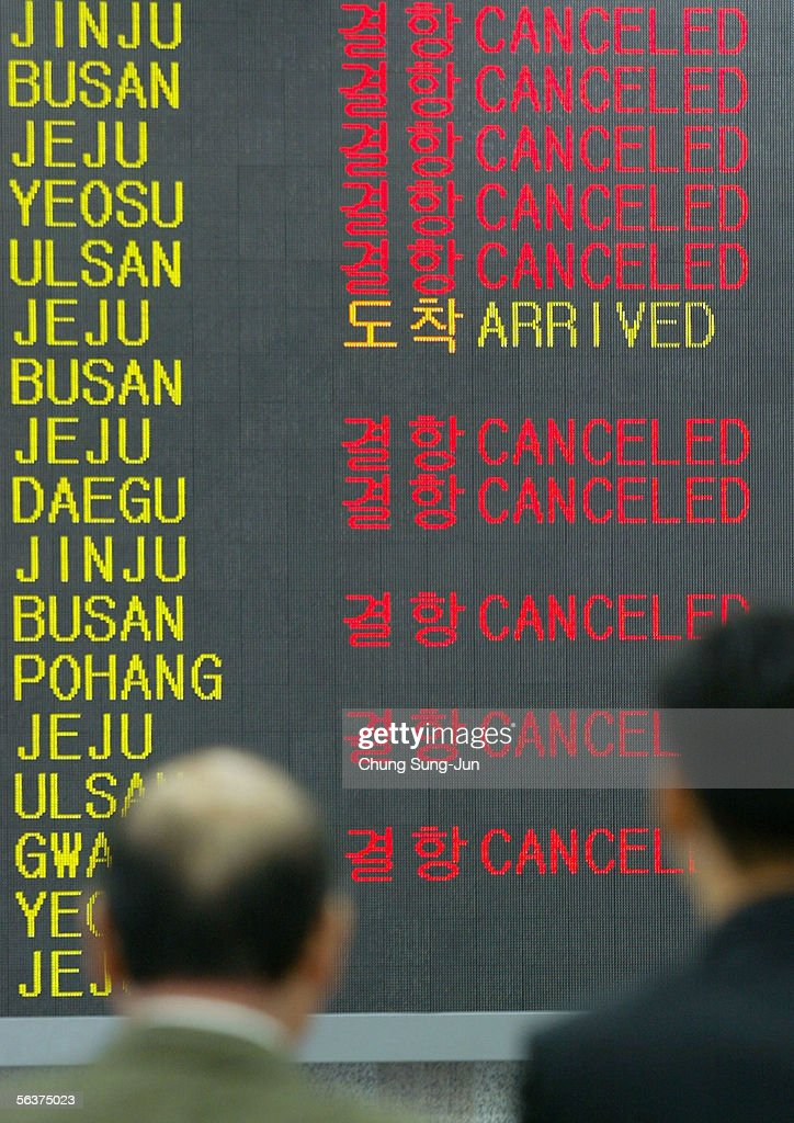 Korean air union members take strike action photos and images passenger look at the flight information boards at gimpo airport december 8 2005 in seoul publicscrutiny Images