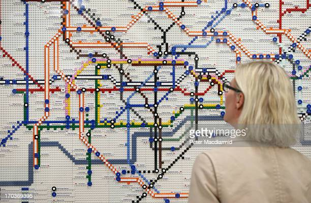 A passenger looks at a Lego tube map showing the future in the year 2020 at Kings Cross Station on June 12 2013 in London England Five tube maps have...