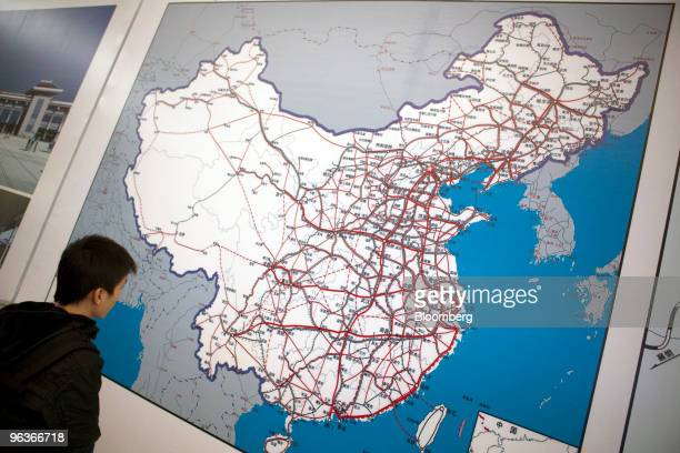 Passenger looks at a map of the China rail network inside the new Guangzhou South Railway Station in Guangzhou, China, on Tuesday, Feb. 2, 2010. The...