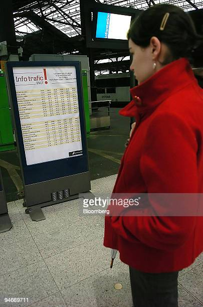 A passenger looks at a sign announcing delayed trains during a national rail strike at Gare SaintLazare train station in Paris France on Wednesday...