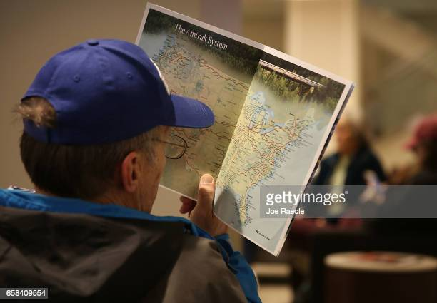 A passenger looks at the Amtrak system map while waiting at Union station where Amtrak's California Zephyr makes a daily 2438 miles run to...