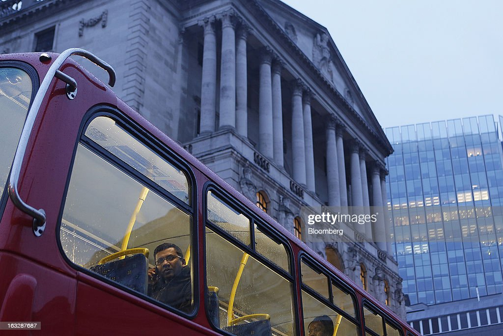 A passenger looks from the window of a London bus as it passes the Bank of England (BoE) in London, U.K., on Thursday, March 7, 2013. The pound dropped to its weakest level in more than 2 1/2 years versus the dollar before Bank of England policy makers announce their decision on whether they will add more stimulus to boost the U.K. economy. Photographer: Simon Dawson/Bloomberg via Getty Images