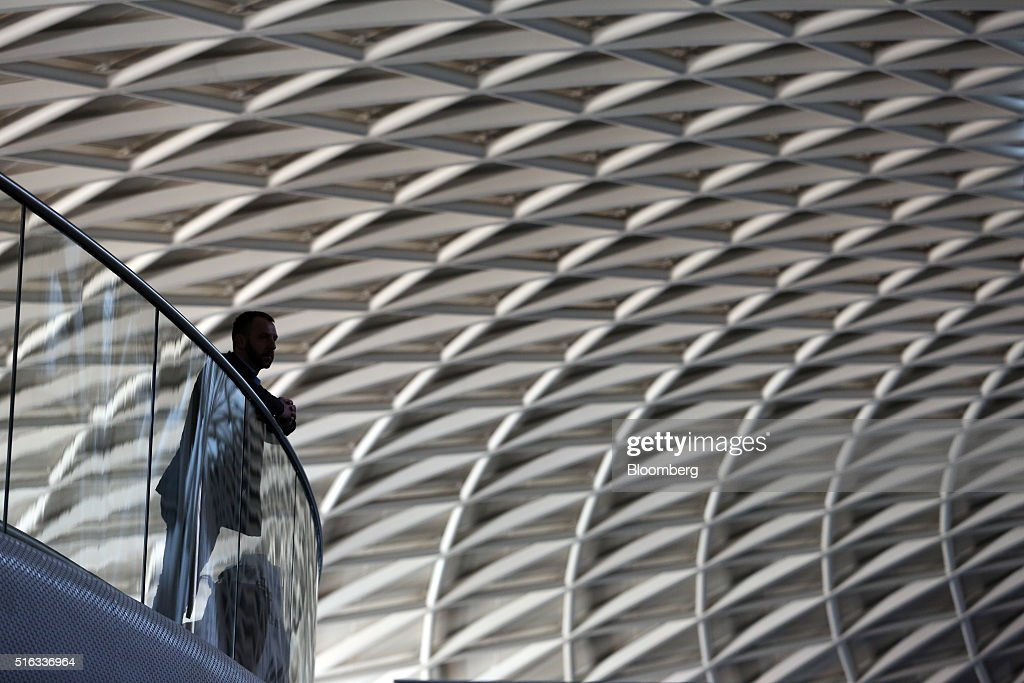 A passenger looks out from a balcony viewing area at Kings Cross station, in London, U.K., on Friday, March 18, 2016. Virgin Trains will revive plans to offer high-speed Internet access on Europes busiest rail route in a bid to beat the plane and persuade business people to travel outside peak hours. Photographer: Chris Ratcliffe/Bloomberg via Getty Images