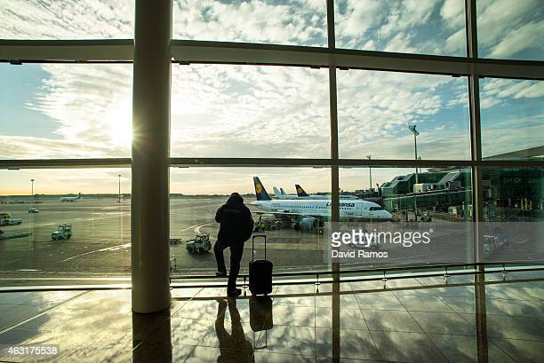 A passenger looks out of the windows at Aena operated Barcelona El Prat International Airport on February 11 2015 in Barcelona Spain Shares in...