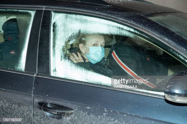 Passenger of a car is seen with a face mask at the Ikla crossing point between Estonia and Latvia on March 14, 2020 as the government has declared a...
