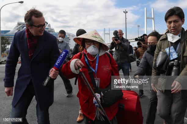Passenger of Diamond Princess cruise ship leaves Daikoku Pier on February 19, 2020 in Yokohama, Japan. About 500 passengers who have tested negative...