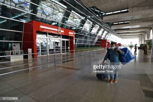 A passenger of the special flight for Afghanistan arrives at deserted departure terminal of T3 during national lockdown to curb the spread of...