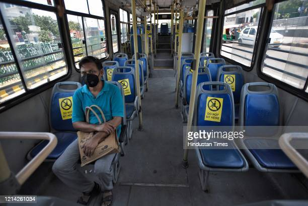 A passenger on board in a DTC Bus after government eased lockdown restriction at AIIMS on May 20 2020 in New Delhi India