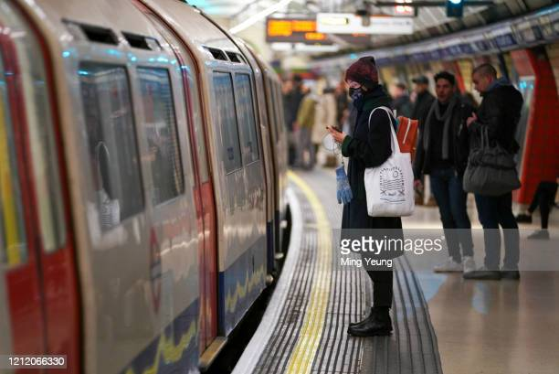 Passenger on the London Underground wears a surgical mask during the Coronavirus pandemic in London on March 12 2020 in London England The Prime...