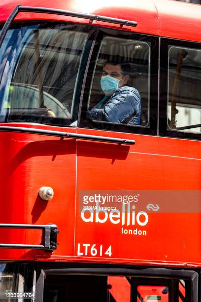 Passenger on the top deck of a bus seen wearing a face mask. The mandatory wearing of Face masks on public transport in England is to end on the 19th...