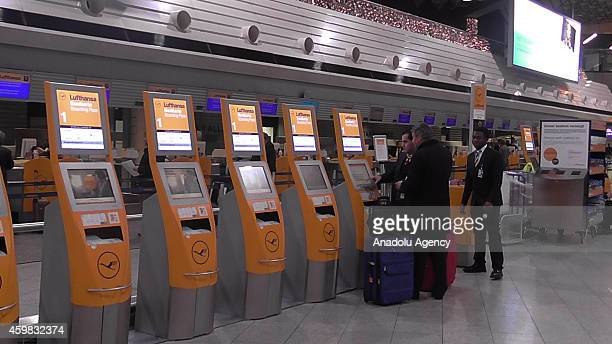 Passenger pass try to get a boarding pass at the airport in Frankfurt am Main Germany on December 2 2014 Today the strike has been expanded to...