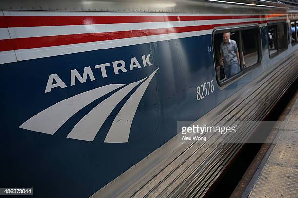 A passenger passes by an Amtrak train September 3 2015 at Union Station in Washington DC US Secretary of Homeland Security Jeh Johnson held a press...