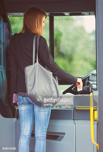 passenger paying the bus fare with a contacless card - fare stock pictures, royalty-free photos & images