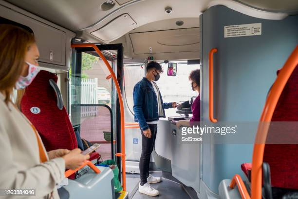 passenger paying with his phone - bus stock pictures, royalty-free photos & images