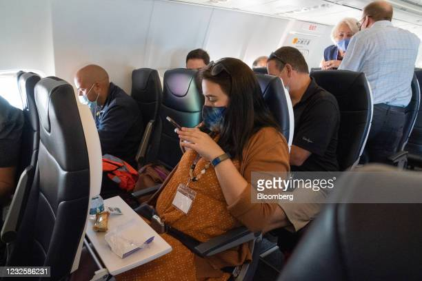 Passenger photographs the in-flight service during the Avelo Airlines inaugural flight from Hollywood Burbank Airport in Burbank, California, to...