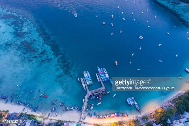 passenger pier on phi phi island kra bi thailand at twilight aerial view - colors soundtrack stock pictures, royalty-free photos & images