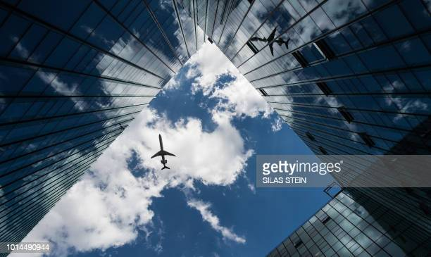A passenger plane flies over the Main Airport Center in Frankfurt am Main western Germany during a demonstration for better working conditions at...