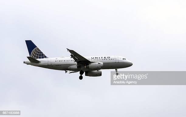 A passenger plane of United Airlines flies over Chicago United States on April 11 2017 Passengers who couldn't be convinced to fly next flight are...