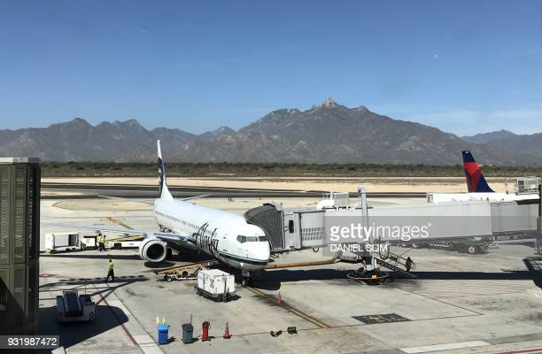A passenger plane operated by Alaska Airlines remains parked at Los Cabos International Airport in Los Cabos Baja California Sur state Mexico on...