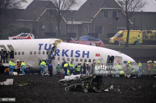 Passenger plane operated by Turkish Airlines lies broken after crashing while trying to land at Schiphol airport in Amsterdam on February 25, 2009....