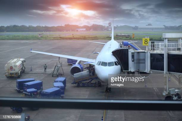 passenger plane standing at dabolim airport, goa, india - aerial transport building stock pictures, royalty-free photos & images