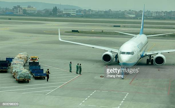 A passenger plane stops on tarmac for ground service before take off The year of 2015 is the most profitable year for Chinas aviation industry In...