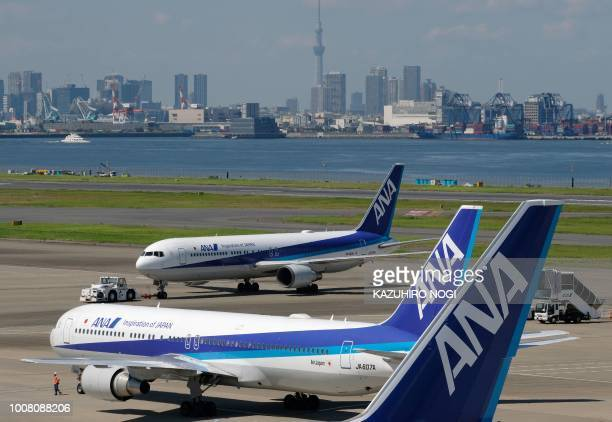 Passenger planes of All Nippon Airways are seen at Tokyo's Haneda airport on July 31 2018 Major Japanese carriers All Nippon Airways and Japan...
