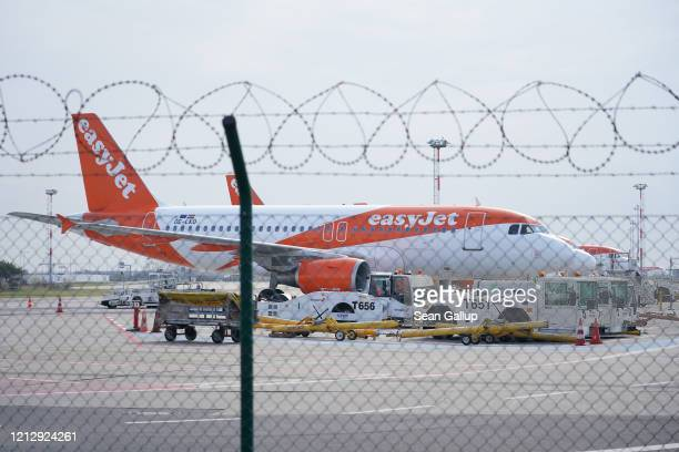 Passenger planes of discount airline EasyJet stand on the tarmac at BerlinSchoenefeld Airport on March 17 2020 in Schoenefeld Germany EasyJet and...