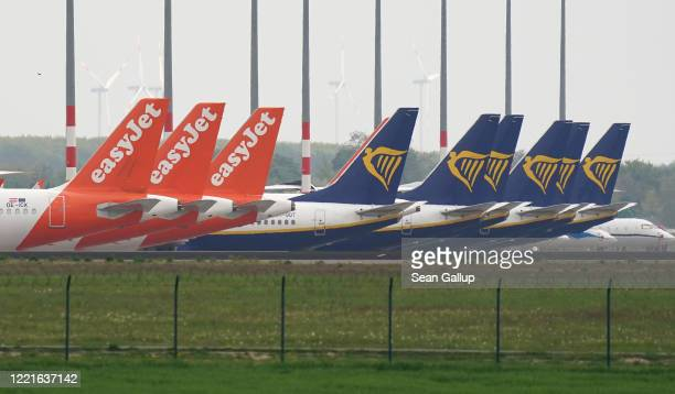 Passenger planes of discount airliners EasyJet and Ryanair stand parked and not in use at Willy Brandt Berlin Brandenburg International Airport...