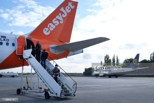 Passenger planes of discount airlines EasyJet and Ryanair stand on the tarmac at Tegel airport on May 14 2019 in Berlin Germany Berlin with its Tegel...