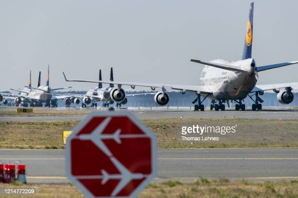 Passenger planes of German airline Lufthansa stand parked and pulled from service at Frankfurt Airport on March 25, 2020 in Frankfurt, Germany....