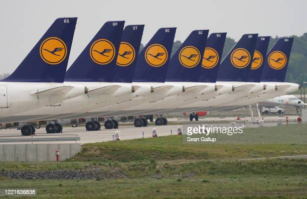 Passenger planes of German airliner Lufthansa stand parked and not in use at Willy Brandt Berlin Brandenburg International Airport during the...