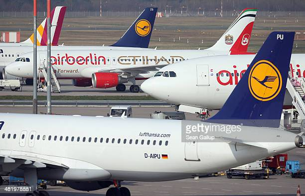 Passenger planes of Germanwings Lufthansa and Air Berlin Germany's three major airlines stand at Tegel Airport on April 2 2014 in Berlin Germany Air...