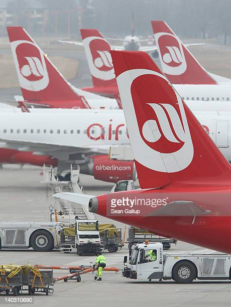 Passenger planes of Germany's secondbiggest airline Air Berlin stand on the tarmac at Tegel Airport on March 2 2012 in Berlin Germany Air Berlin CEO...