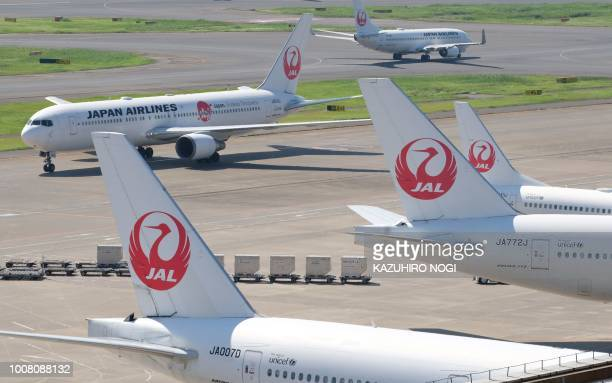 Passenger planes of Japan Airlines are seen at Tokyo's Haneda airport on July 31 2018 Major Japanese carriers All Nippon Airways and Japan Airlines...