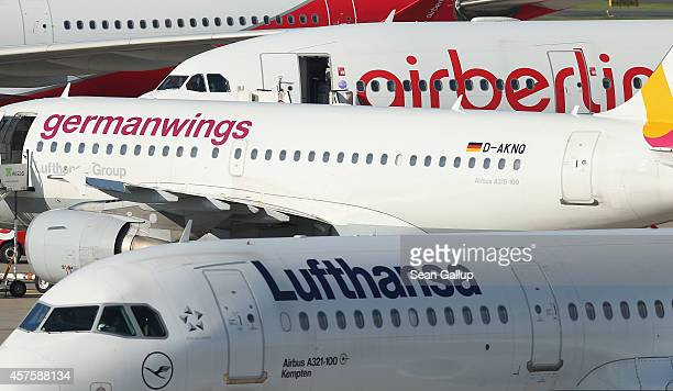 Passenger planes of Lufthansa, Germanwings and Air Berlin stand on the tarmac at Tegel Airport on October 21, 2014 in Berlin, Germany. The three are...