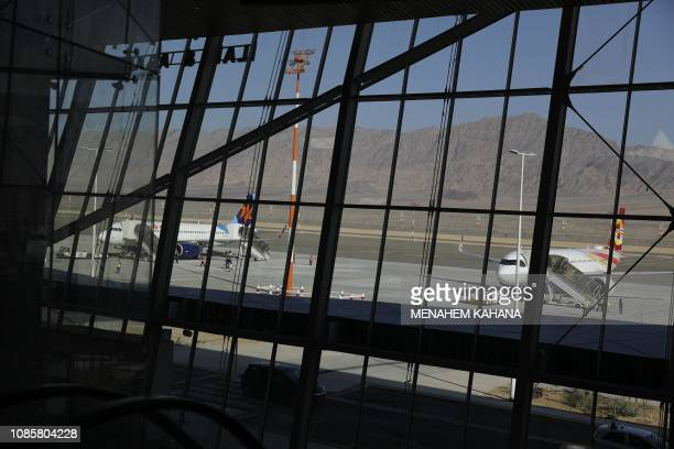 Passenger planes prepare to take off at the new international Ramon Airport located some 18 kilometres north of the southern Israeli Red Sea resort...