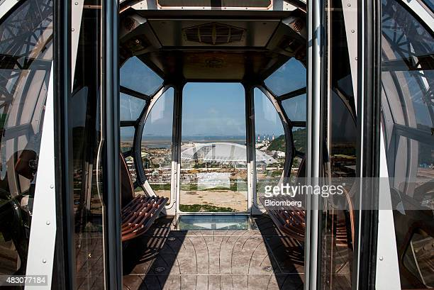 A passenger pod sits on a Ferris wheel at the Studio City casino resort developed by Melco Crown Entertainment Ltd under construction in Macau China...