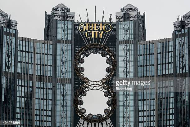 Passenger pods sit on ferris wheels at the Studio City casino resort, developed by Melco Crown Entertainment Ltd., in Macau, China, on Monday, Oct....
