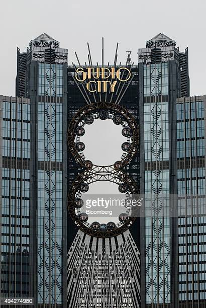 Passenger pods sit on ferris wheels at the Studio City casino resort developed by Melco Crown Entertainment Ltd in Macau China on Monday Oct 26 2015...