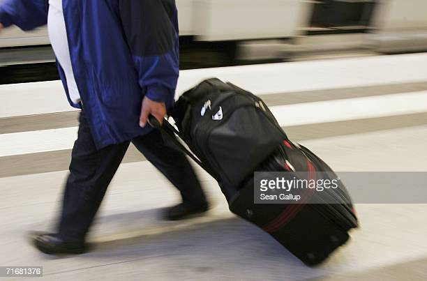 A passenger pulls their baggage at Hauptbahnhof main railway station August 20 2006 in Berlin Germany The country is on high alert after suitcases...