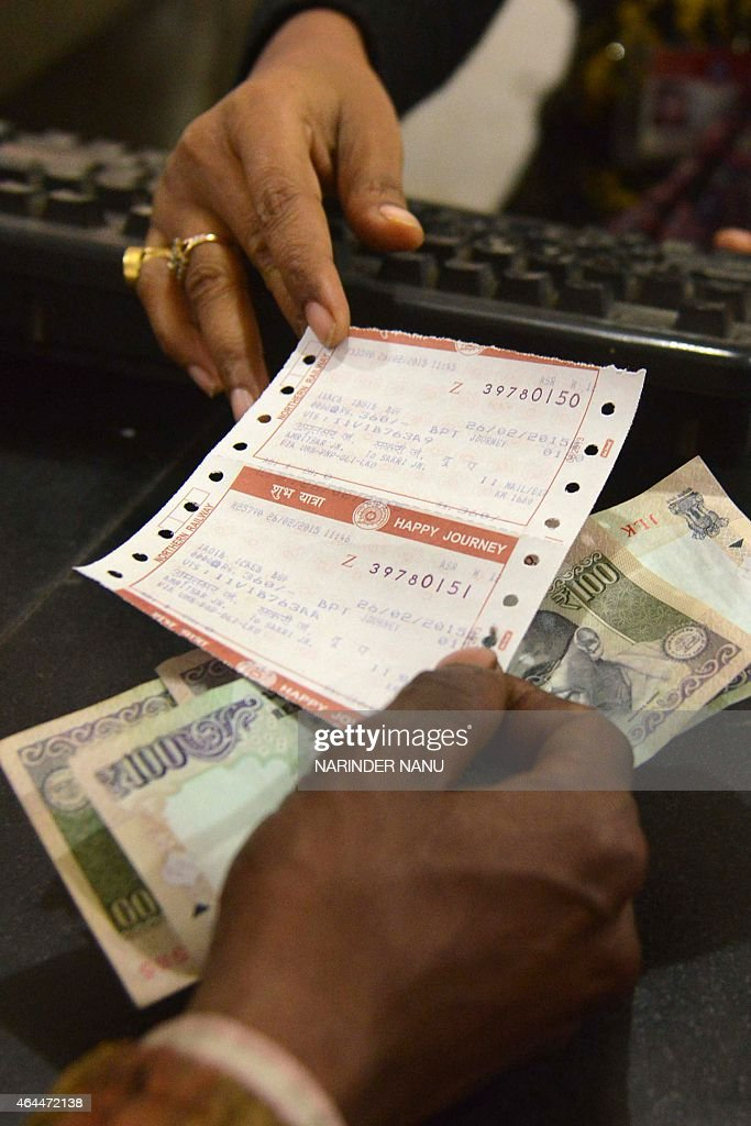 A passenger purchases a train ticket at a railway station in Amritsar on February 26 2015 India said it would spend 137 billion dollars to modernise..