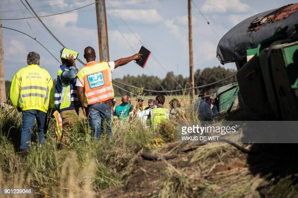 Passenger Rail Agency South Africa inspectors look at derailed train carriages after an accident near Kroonstad in the Free State Province some...