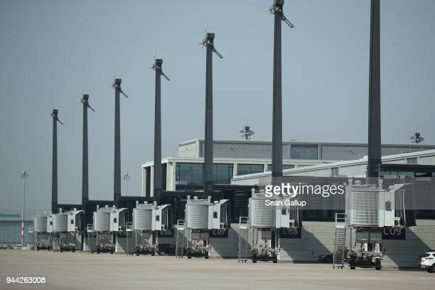 Passenger ramps stand at the tarmac at the BER Willy Brandt Berlin Brandenburg International Airport on April 10 2018 in Schoenefeld Germany...