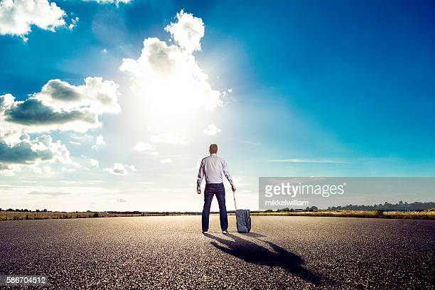 Passenger ready for vacation stands on airfield waiting for plane