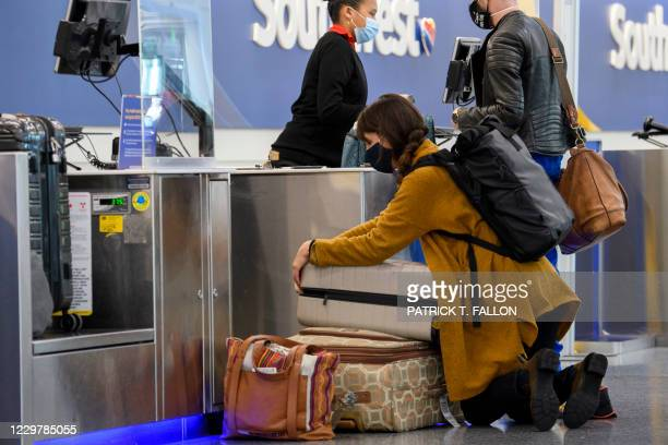 Passenger repacks a bag while checking in for a Southwest Airlines flight at Los Angeles International Airport ahead of the Thanksgiving holiday in...