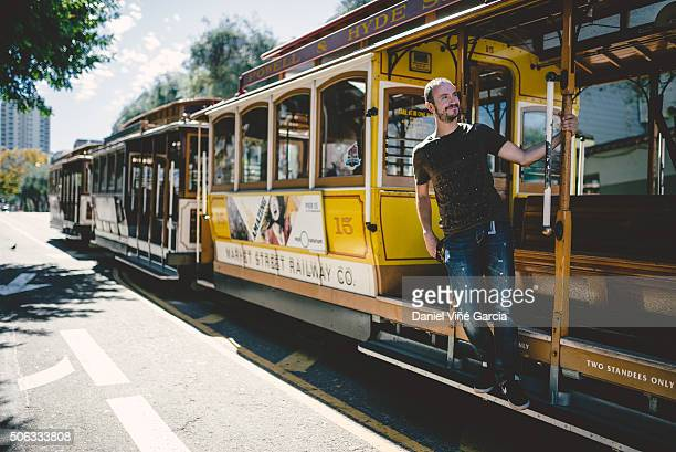 SAN FRANCISCO Ca. - September 26: Passenger ride in a cable car on September 26, 2015 in San Francisco. It is the most popular way to get around the City of San Fransisco.