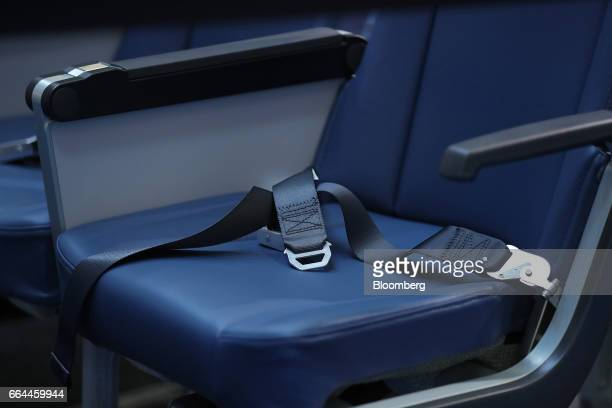 Passenger safety belt sits on an aircraft seat at the 2017 Aircraft Interiors Expo in Hamburg, Germany, on Tuesday, April 4, 2017....